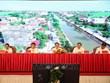 红河平原与中部以北地区新农村达标乡占近70%