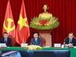 越共中央书记处常务书记武文赏与老挝人民革命党中央书记处常务书记本通·吉玛尼举行视频会谈