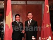越南政府副总理兼外长范平明会见中国外交部长王毅