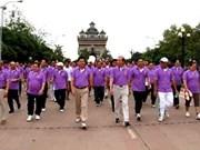 老挝举行健身步行活动 庆祝东盟成立48周年