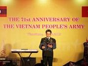 越南人民军建军71周年纪念典礼在老挝举行