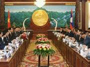 越南国家主席陈大光与老挝人民革党总书记、国家主席本扬•沃拉吉举行会谈