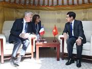 越南外交部长范平明在第十一届亚欧首脑会议进行各场双边会晤