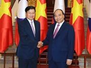 越南政府总理阮春福会见老挝总理和波音民用飞机集团总裁兼首席执行官(组图)