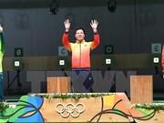 越南射击选手黄春荣为越南代表团获得奥运会历史上的首枚金牌(组图)