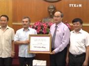 越南通讯社捐款帮助中部灾区灾民