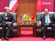 越南政府总理阮春福会见泰国副总理颂吉•乍都斯披塔