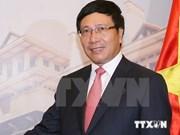 越南政府副总理兼外交部长范平明对老挝进行正式访问