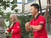 马来西亚青年志愿者在胡志明市留下浓重的一笔
