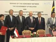 马来西亚与新加坡两国刚在吉隆坡签署马新高铁双边协定