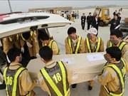 组图:首批16具英国货车案遇难者遗体已经运回越南