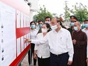 组图:国家主席阮春福与古芝县和霍门县第十五届国会代表候选人举行工作会议