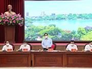 """范明政总理:河内市要坚持实施""""双重目标"""""""