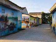 越南旅游:承天顺化省渔美盛渔村美丽的农舍壁画(组图)