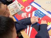 首都学生热烈欢迎美朝领导人第二次会晤