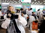 组图:越南革命新闻日 96 周年:越通社记者奔赴一线抗战疫情