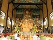 旅居老挝越南人举行活动纪念各位在老越南长老