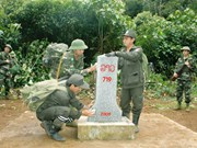 越南广南省祖国阵线委员会与老挝塞公省建国阵线委员会携手共建越老和平友好边界线