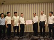 越南驻老挝大使馆工作人员捐款援助北部山区洪水受灾民众
