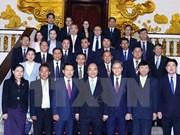 越南政府总理阮春福会见老挝外交部长