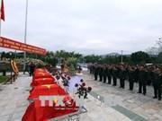 在老挝战场牺牲的越南志愿军烈士遗骸安葬仪式举行