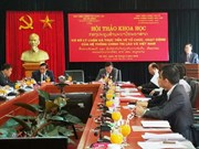 越南与老挝分享政治系统运行经验