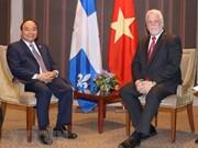 政府总理阮春会见加拿大魁北克省省长菲利普·库亚尔