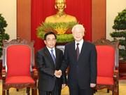 越共中央总书记阮富仲会见老挝党、国家高级代表团