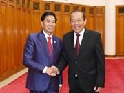 越南政府常务副总理张和平会见万象市委书记兼市长辛拉冯·库派吞