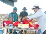 为在老挝牺牲的30具越南专家和志愿军遗骸举行归国仪式