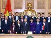 政府总理阮春福会见获得2018年国家知名品牌的企业代表