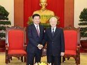 越共中央总书记、国家主席阮富仲会见老挝总理通伦