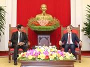 越共中央经济部部长阮文平会见老挝国家经济研究院工作代表团