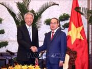 胡志明市市委书记阮善仁会见新加坡副总理张志贤