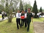 清化省为18具在老挝牺牲的越南烈士遗骸举行追悼会和安葬仪式