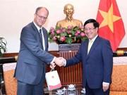 越南政府副总理范平明会见德国驻越大使克里斯蒂安·伯杰