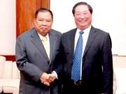 老挝国家副主席会见越南政府民族委员会高级代表团