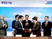 越通社与军队股份银行签署全面合作协议