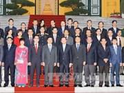 """越南国家主席会见荣获""""越南国家品牌""""称号的63家企业代表"""