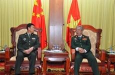 越南国防部副部长阮志咏上将会见云南省军区司令员杨光跃少将