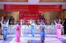 旅居老挝越南人举行集会庆祝越老两党全国代表大会成功召开