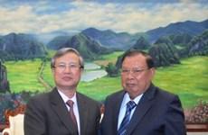 老挝党、国家领导人会见越共中央检查委员会代表团