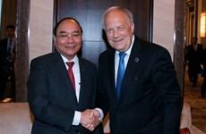 越南政府总理阮春福会见出席第十一届亚欧首脑会议的各国领导人