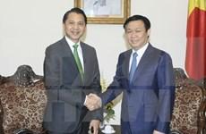 越南政府副总理王廷惠会见泰国开泰银行行长