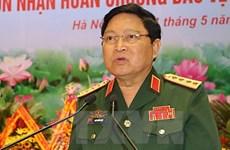 越南防长吴春历大将会见泰国与新加坡驻越大使