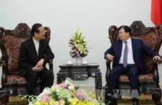 越南政府副总理郑廷勇会见泰国安美德集团董事长邱威功