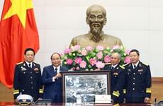 阮春福会见海上胡志明小道传统协会老战士代表团 (组图)