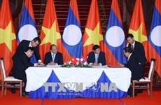 政府总理阮春福与老挝总理通伦·西苏里主持召开越老政府间联合委员会第40次会议(组图)