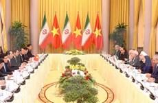 越南国家主席陈大光与伊朗总统哈桑•鲁哈尼举行会谈