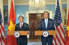 越共中央书记处常务书记丁世兄访问美国